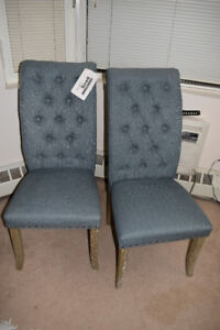 Two chairs with Brushed Rustic Wood Legs and Nailhead Accents