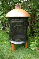 One in a world, Cast Iron Fire Place with a Golden Dome and Legs