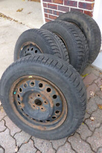 4 winter tires on rims Michelin 215 65 16 / $240