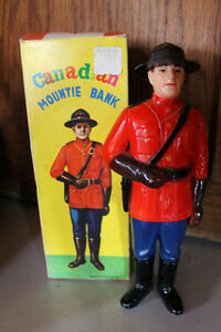VINTAGE CANADIAN MOUNTIE TOY BANK