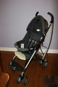 GRACO Stroller. Kids Carrier. Fully functional, green in color.