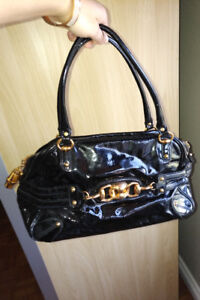 Authentic Gucci handbag black and gold