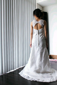 Beautiful brand new wedding gown with train
