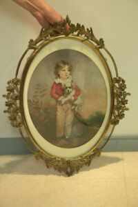 Victorian oval metal picture frame and victorian-style print