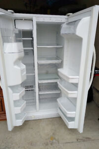 Large white side by side Kenmore Refrigerator/Freezer