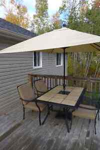 Patio Furniture With Umbrella and Six Chairs
