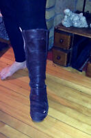 Knee high brown Puma boots