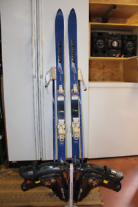 Downhill Skis, Poles and Boots with Boot Carrier