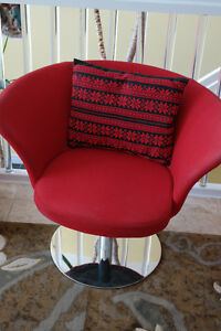 two red swivel chairs