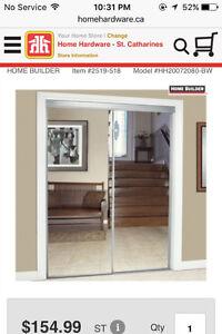 mirrored closet doors-as new in box