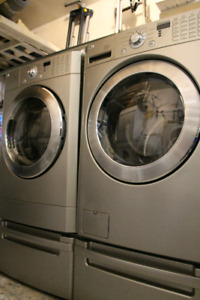 LG front load washer and dryer pair with pedestals
