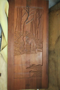 CARVED DOOR ..horse drinking water