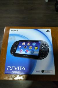 PlayStation VITA avec accessoires et jeu