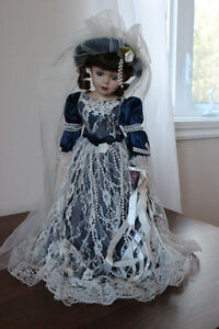 Porcelain Doll with Royal Blue and Lace Dress