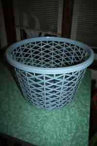 Keep laundry sorted: Blue laundry basket.