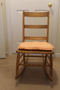 Antique Rocking Chair with design on the seat.