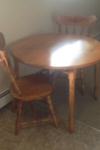 Wooden round table and chairs.