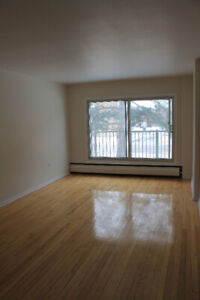 CLEAN & SPACIOUS 3.5 WITH BALCONY. HEATING + HW INCLUDED