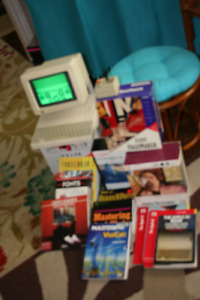 APPLE 2C with Monitor, Joystick, Programs and Books