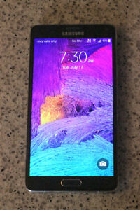 Samsung Galaxy Note 4 with 2 otterbox cases