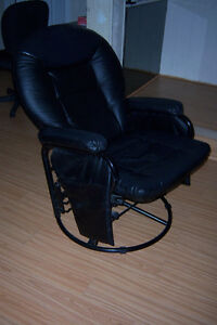 Black  Recliner and swivel Chair with foot rest