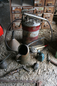 vintage and antique grease guns, oil cans, Alemite pump