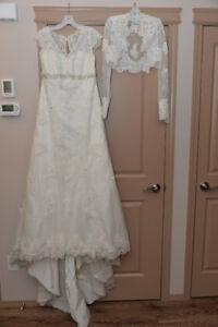 Beautiful ivory Wedding dress with jacket and veil