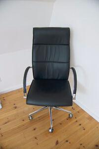 Black quality office chair on 5 wheels