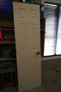 "Interior colonial style door 24""wide x 80"" tall."