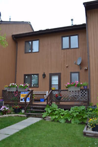 Carefree condo living in lovely lakeside town...