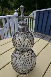 Vintage seltzer/siphon bottle for sale.