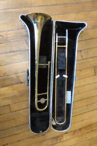 BUNDY TROMBONE WITH MOUTHPIECE AND HARD CASE AND STAND