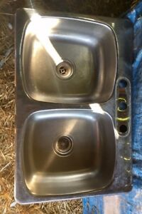Stainless steel double sink.