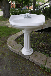 Pedestal sink faucets and plumbing