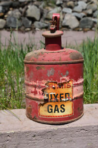 An old chain saw gas can