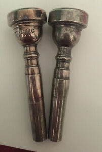 Trumpet mouthpieces, used, 2