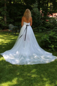 cleaned white wedding dress detachable train