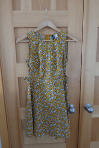 Yellow daisy-print dress with lace-up sides