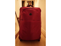 Delsey 4 Wheels Suitcase unisex 24 Inch purple almost NEW