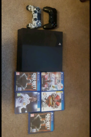 Playstation 4 Console with 5 games and 2 controllers £165