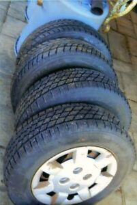 2 Nordic Ice Tires on Kia Rims and 2 Naxen Tires on Mazda Rims