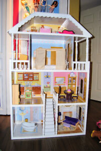 KidKraft Doll House, barbies and accessories - almost new