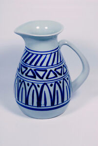Hand thrown, hand painted ceramic pitcher.