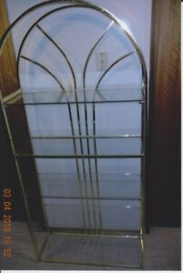 Brass shelving unit with glass shelves