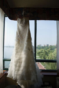 Wedding dress- size 8, tailored to fit a size 6.