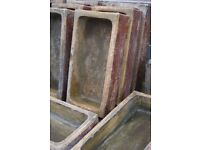 Salt glazed and mustard glaze troughs different sizes ideal flower and herb planters