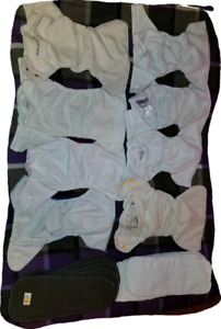 8 gently used cloth pocket diapers