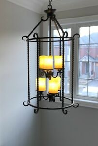 Lighting fixtures with amber frosted glass shades