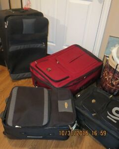 Large suitcases with wheels/ handles