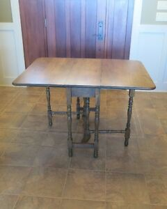 Solid MAPLE drop leaf table.